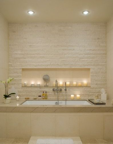 Beige bathroom with candles