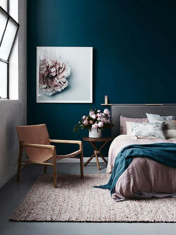 Navy blue bedroom wall and pink accessories | Erika Interiors